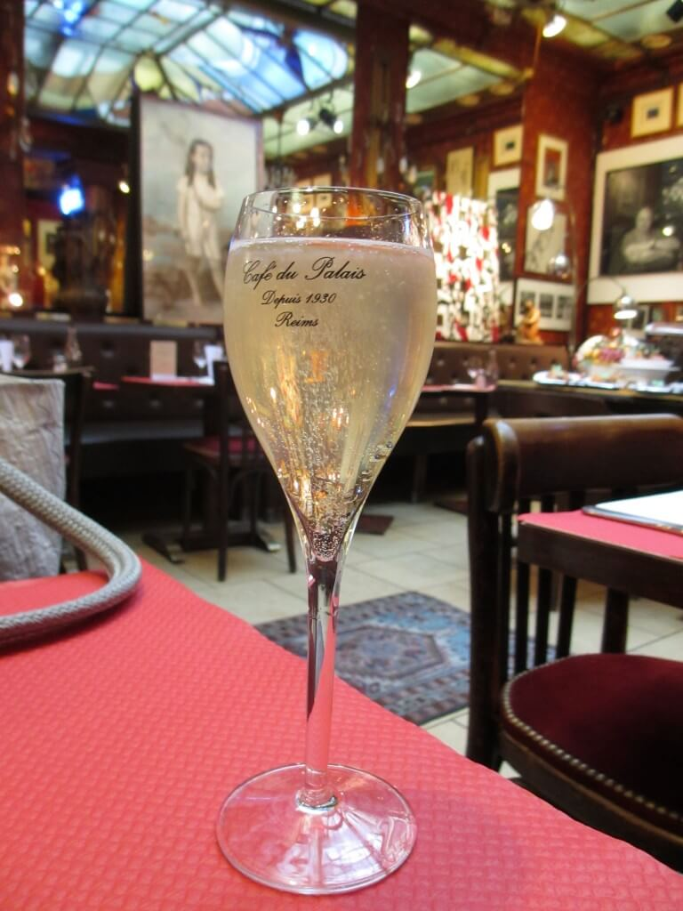 Champagne flute at Cafe du Palais Reims France, how to make a day trip to Reims