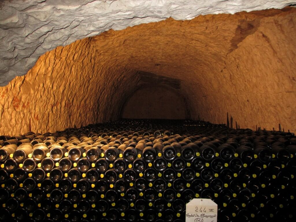 Thousands of bottles deep in the caves at Taittinger Reims France