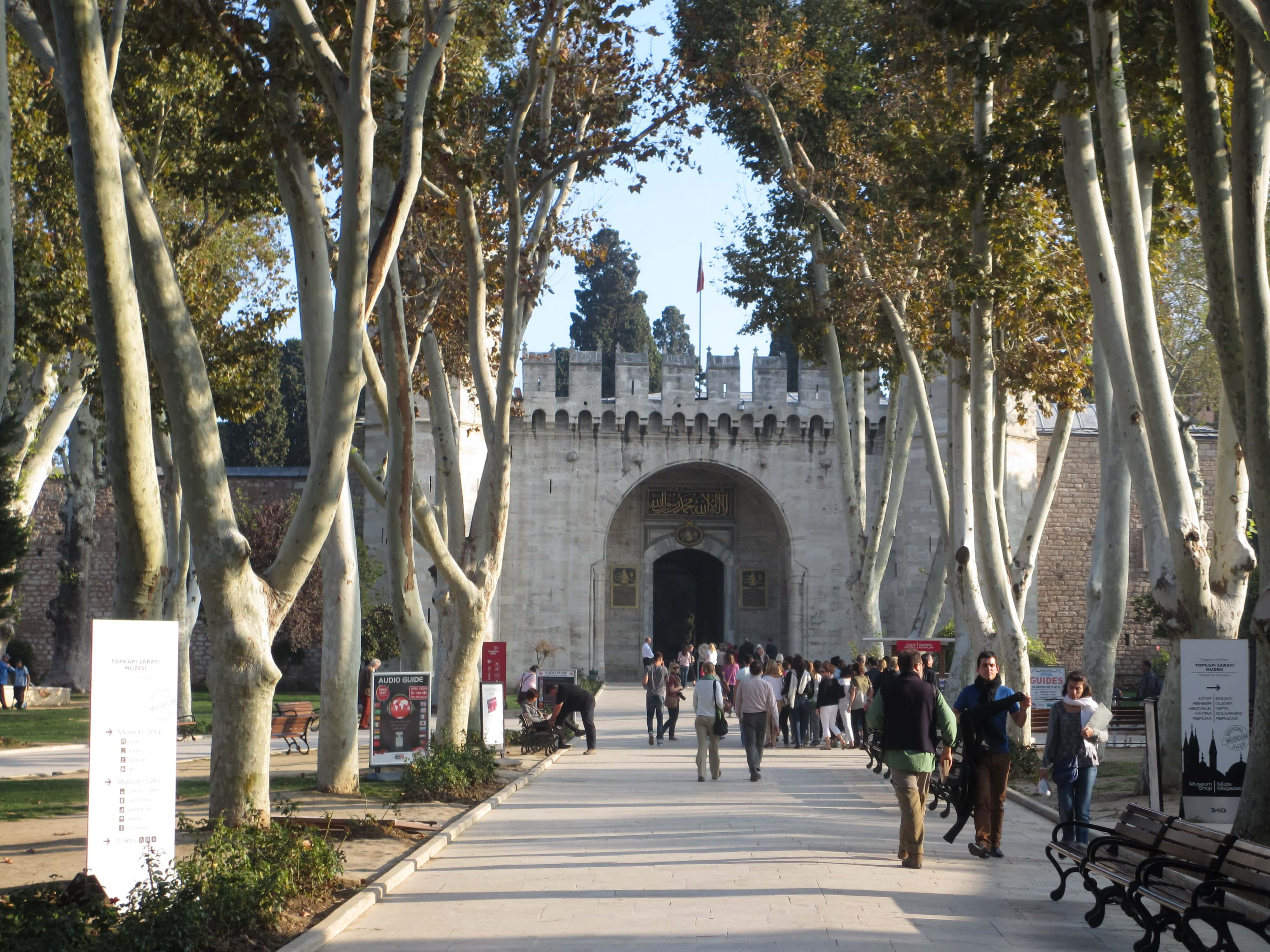 pathway and trees leading to the entrance of the Topkapi Palace gateway in Istanbul