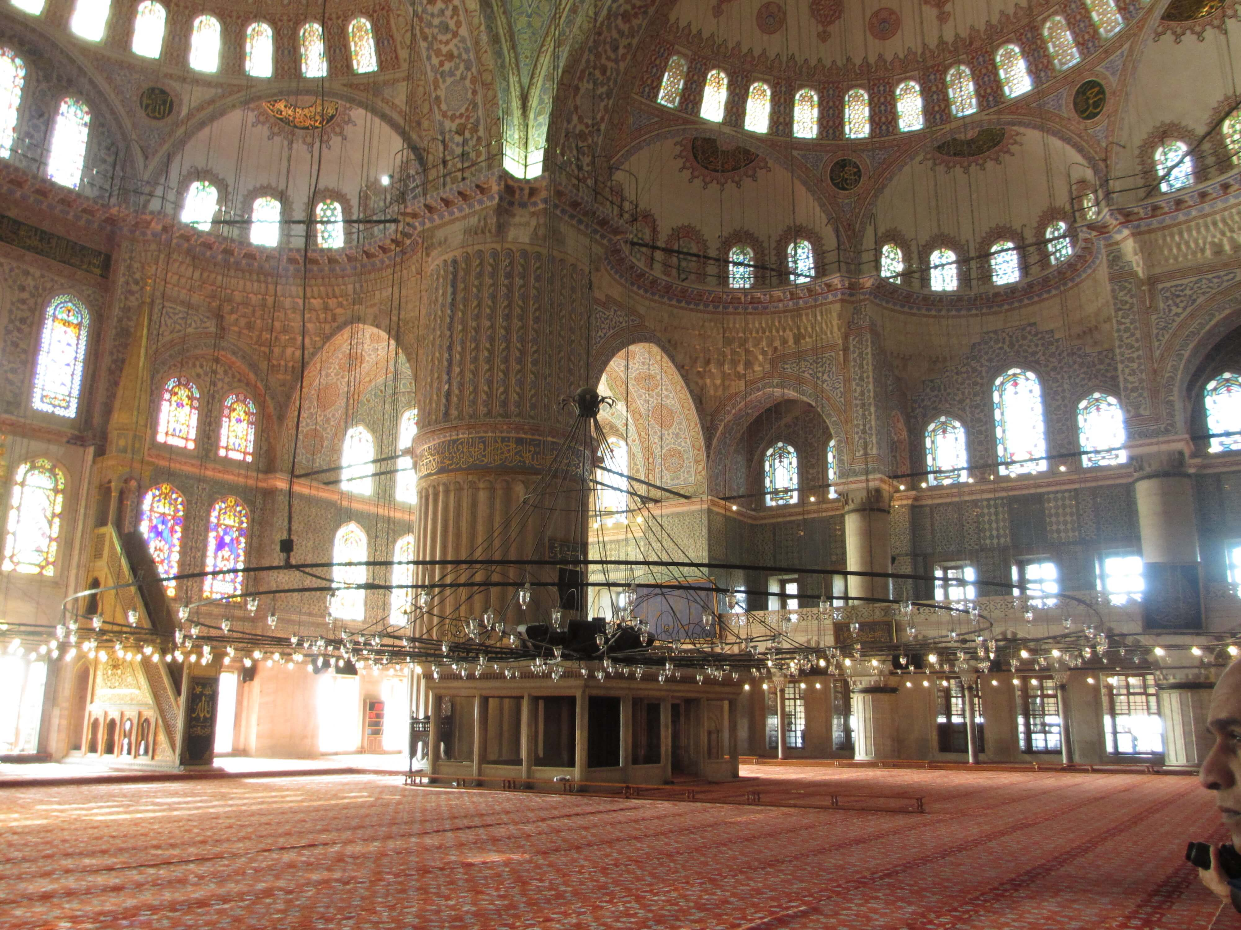 interior of mosque, with lights, domes and windows