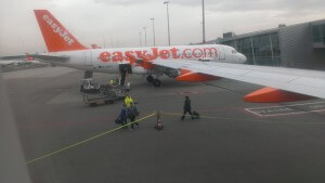 easyJet plane pulled in at the airline gate