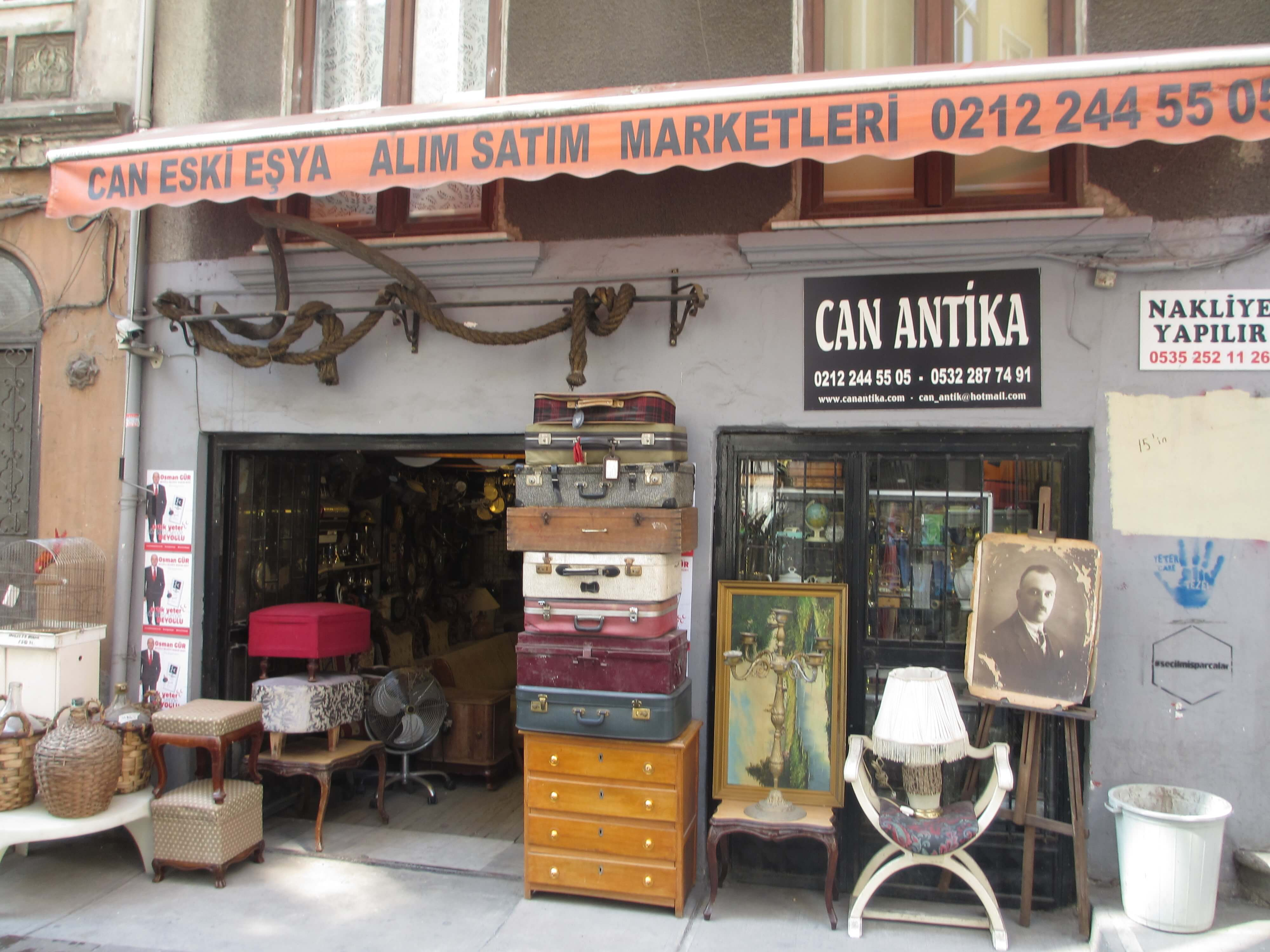 Antique shop with vintage suitcases and chair