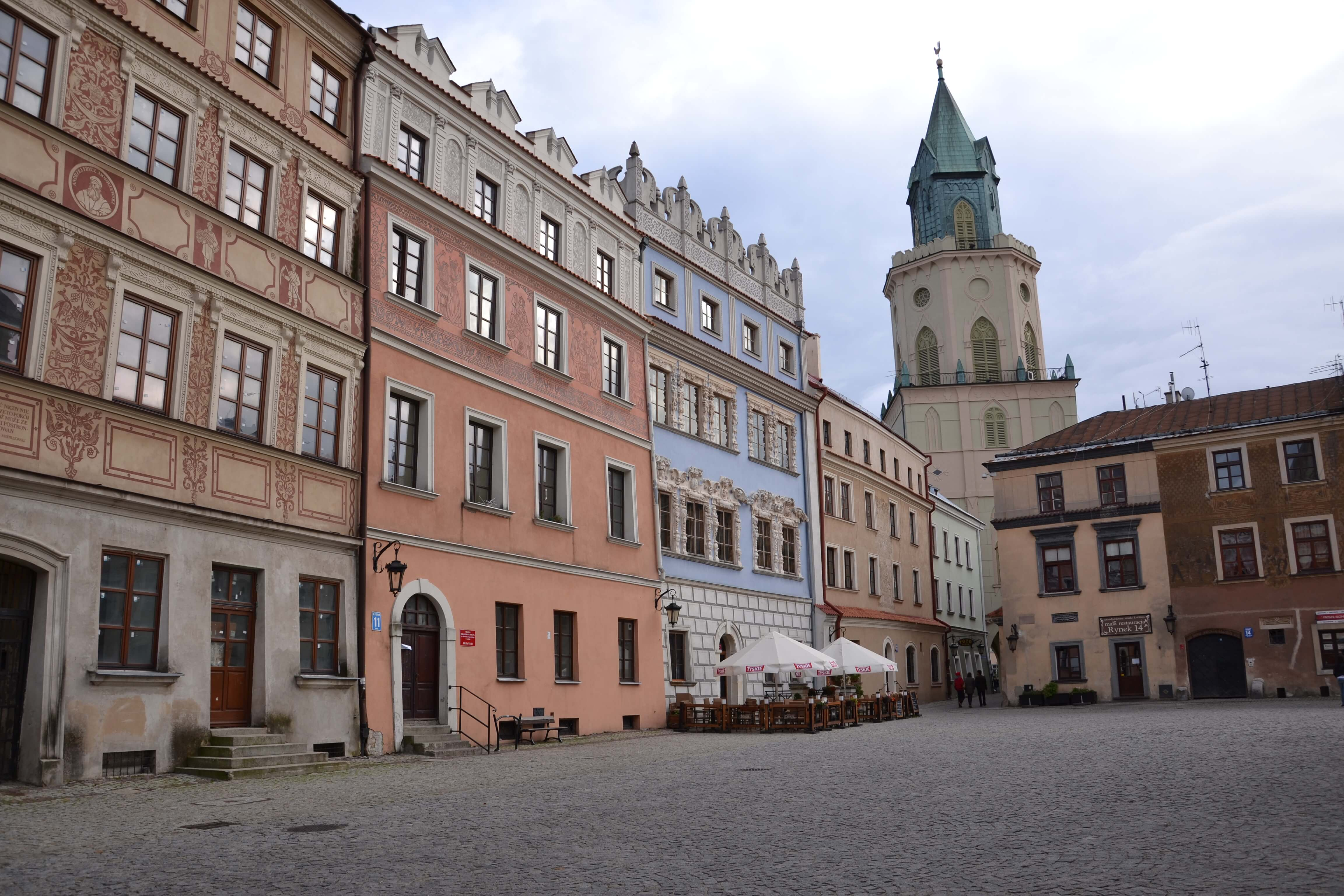 town square with old buildings and a spire