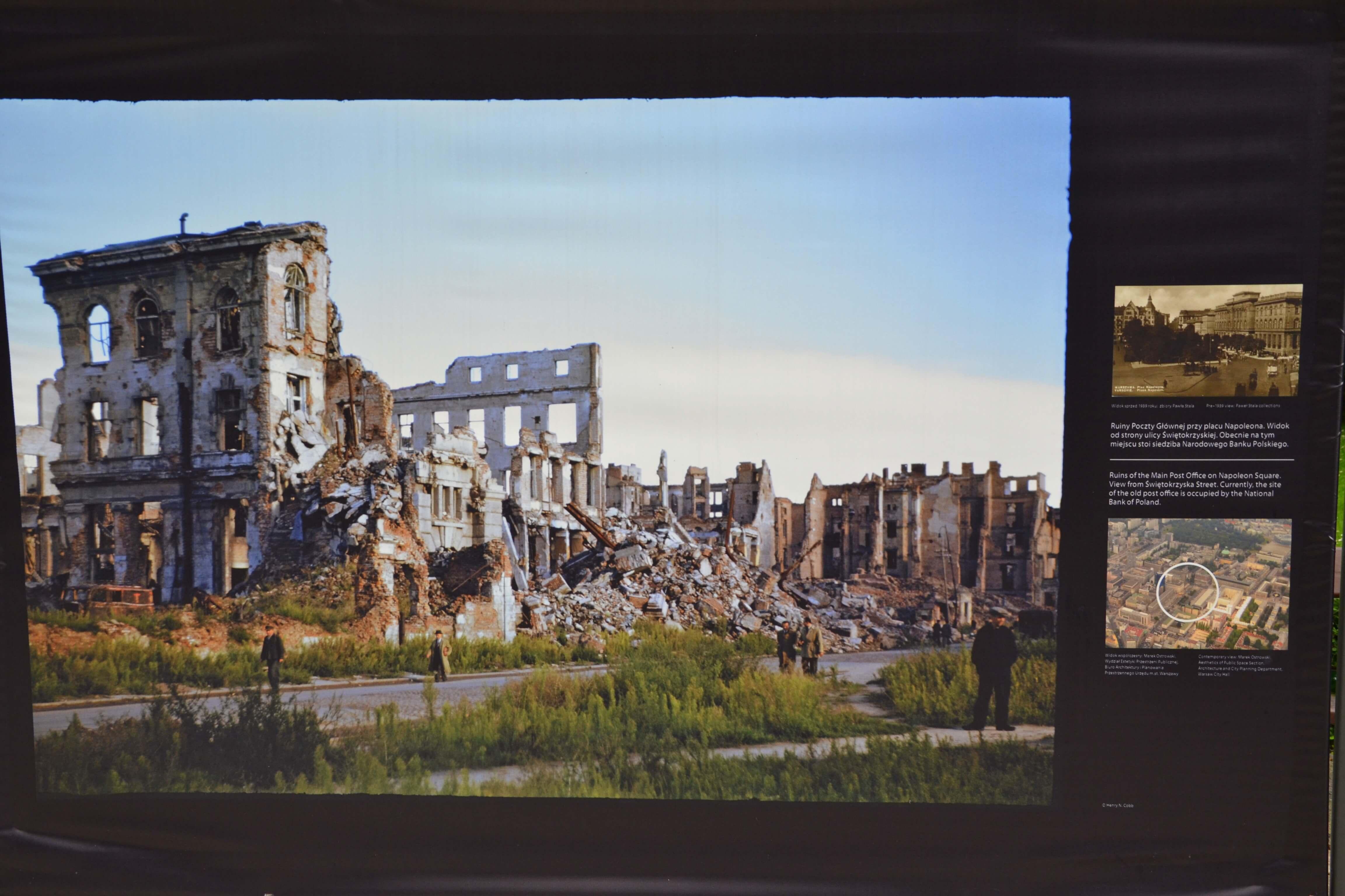 half demolished buildings with people standing looking