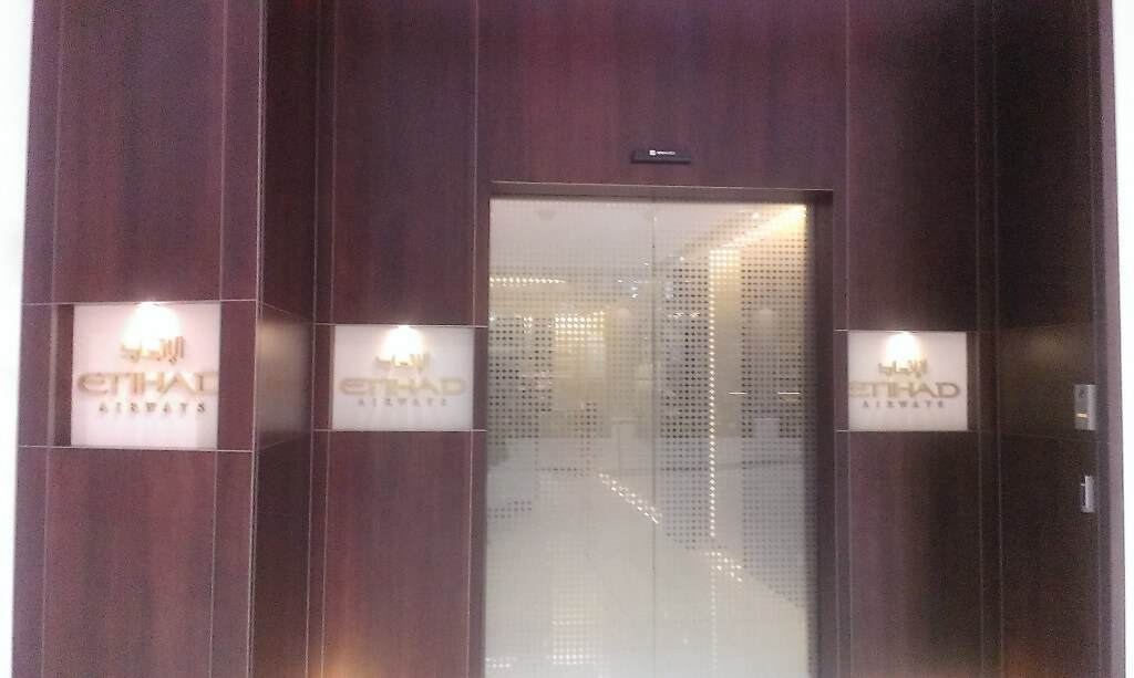 Entrance to Etihad Airways lounge with closed door