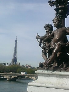 view of Eiffel Tower from the Pont Alexandre III with cherubs in foreground