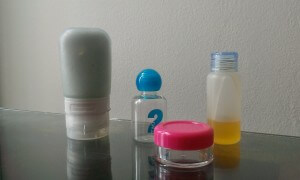 Goo tube, two small plastic bottles, plastic jar