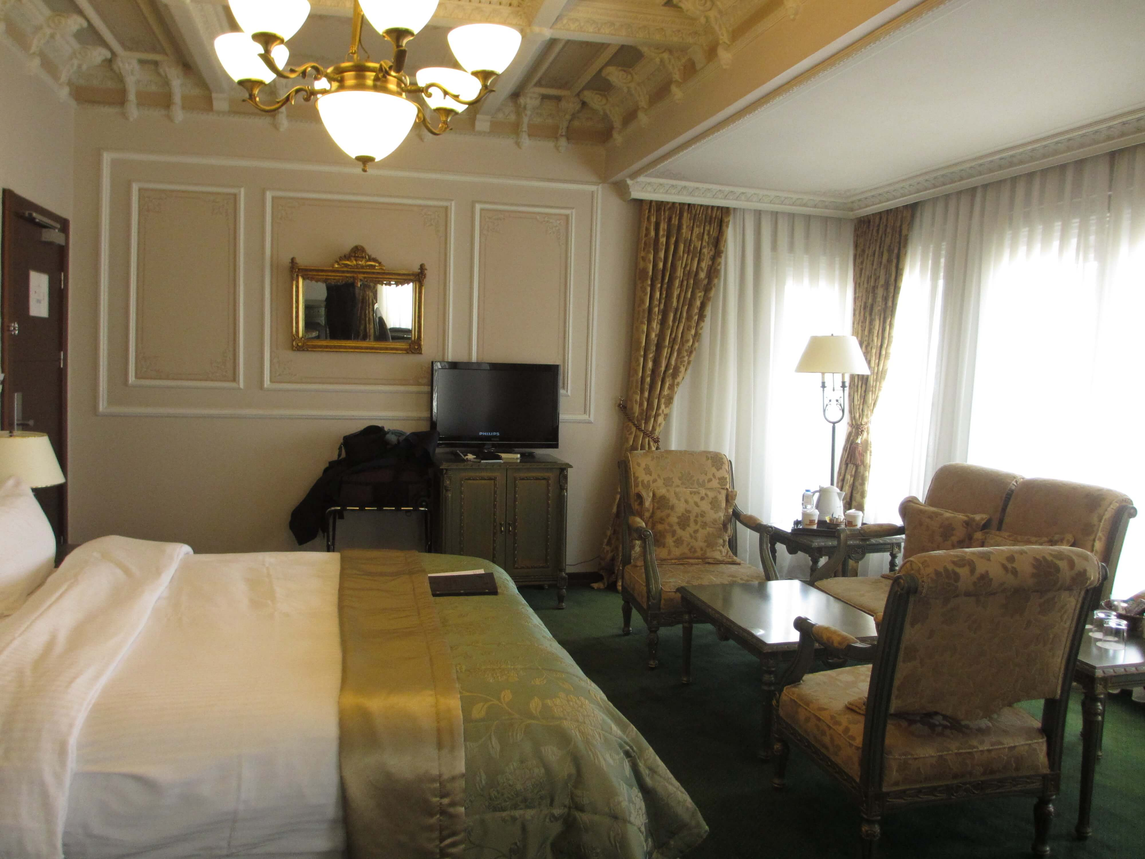 hotel room with king bed and lounge suite