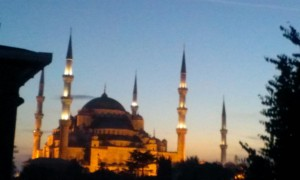 sunset view of the Blue Mosque with minarets and lights