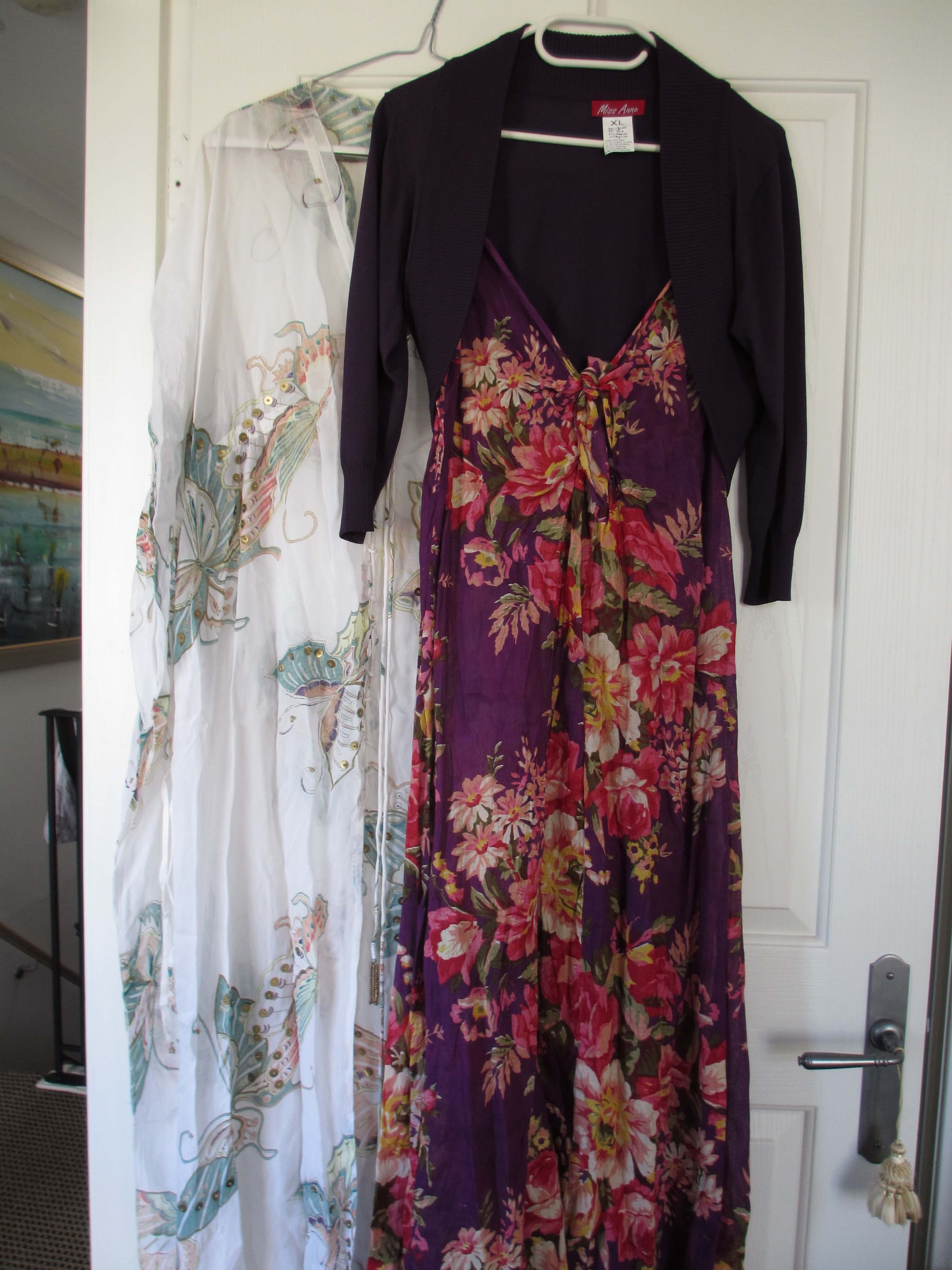 white caftan with butterflies and purple floral maxi dress