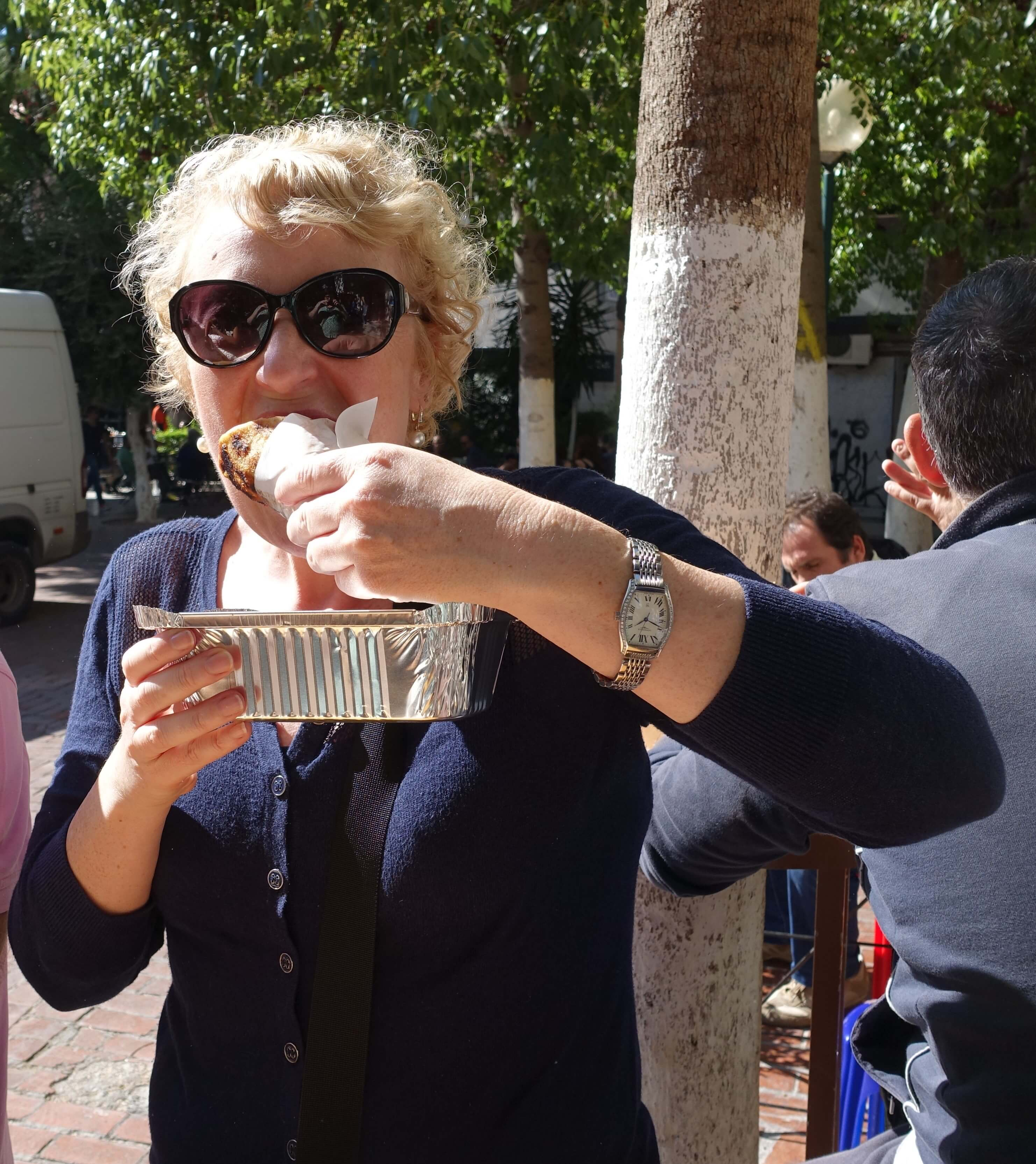 frugalfirstclasstravel Jo Karnaghan eating a Greek souvlaki