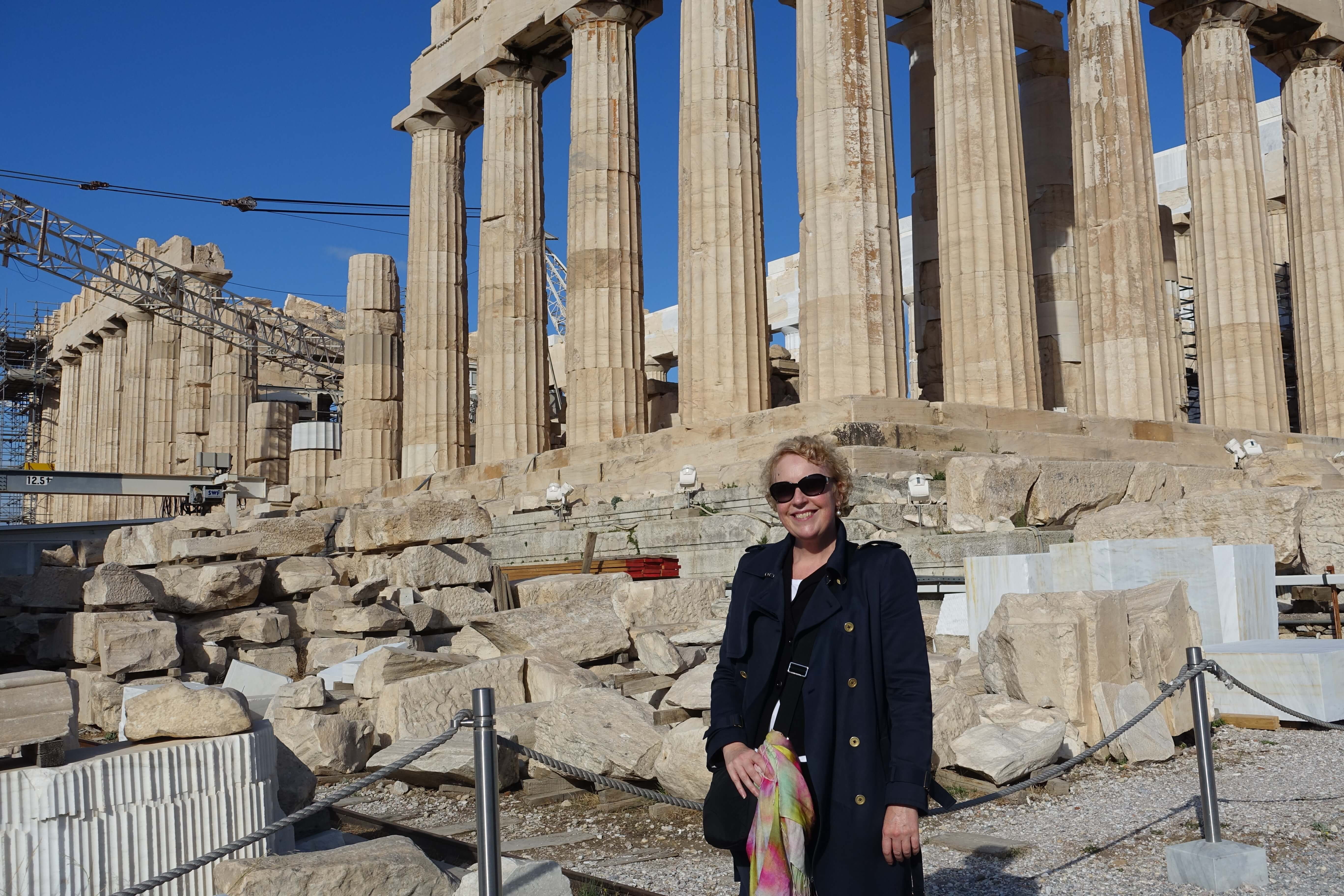 woman standing in front of the Parthenon in Athens