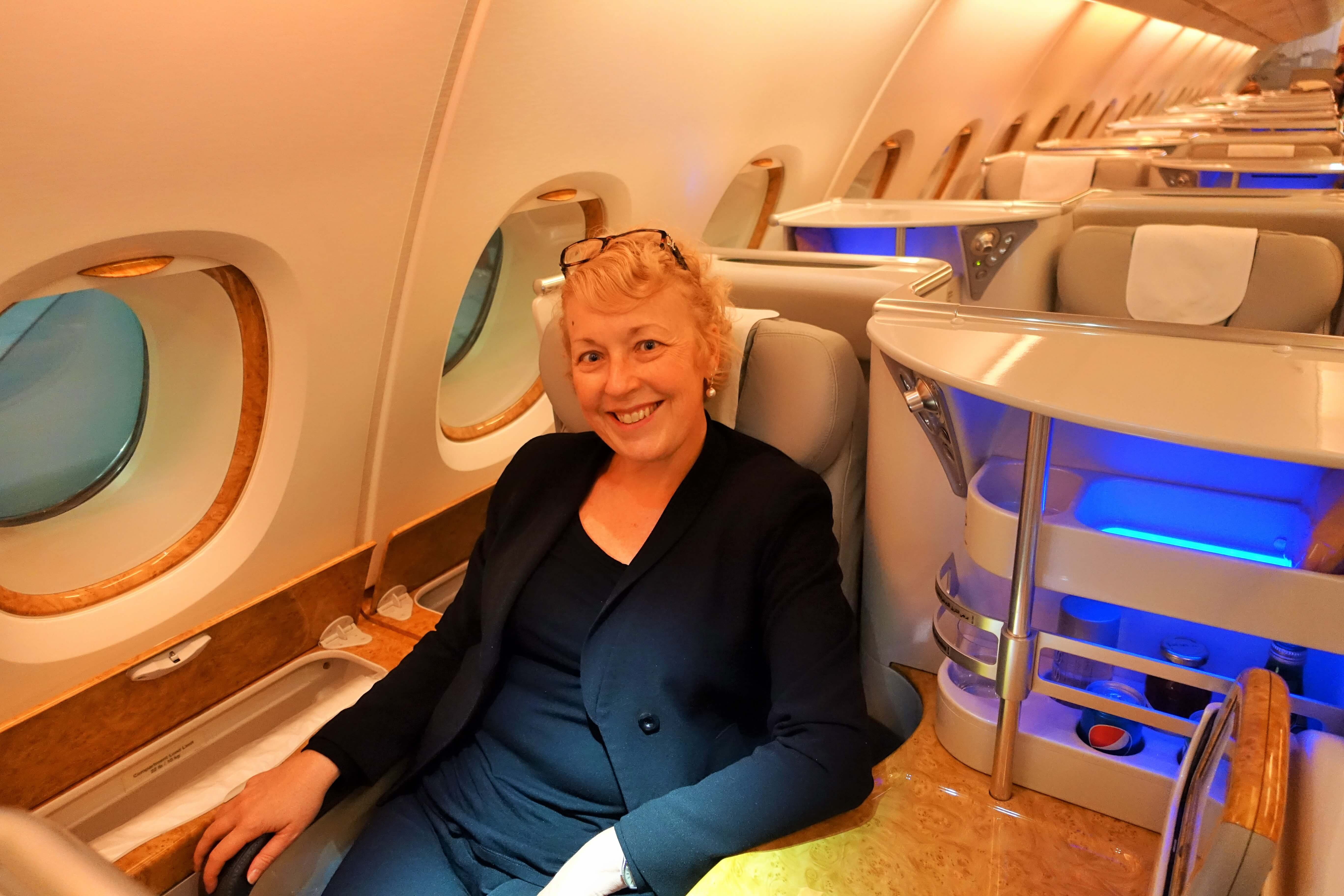 Jo Karnaghan sitting in Emirates A380 Business Class seat
