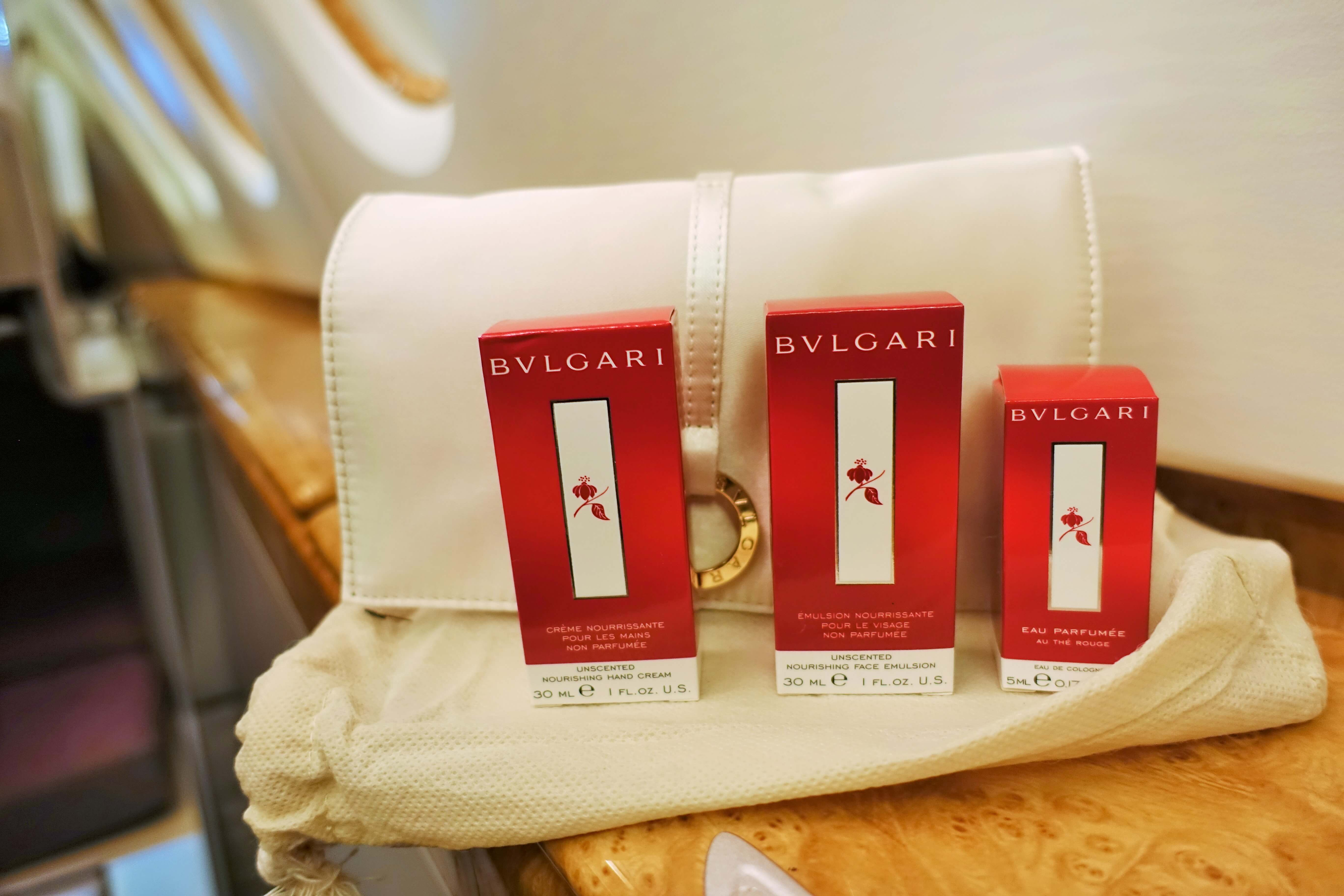 white bulgari toilet bag with Bulgari amenities on Emirates Business Class