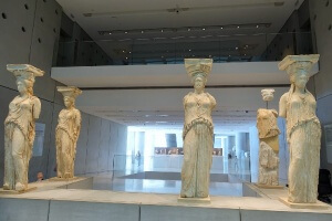 Original statues of the Carytids Visiting the Acropolis and Acropolis Museum frugal first class travel