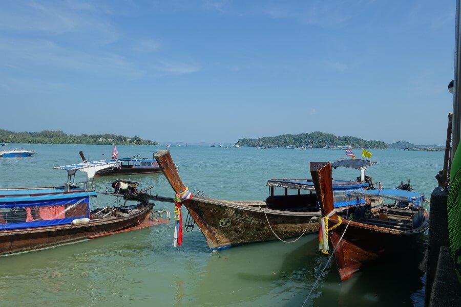 traditional Thai fishing boats on Phang Nga Bay Thailand