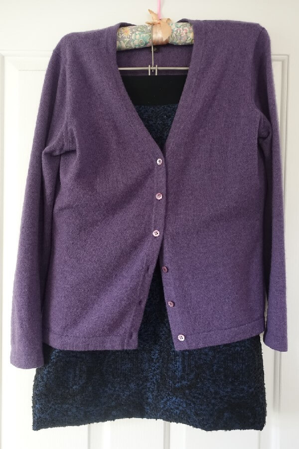 purple cashmere cardigan with blue & black straight skirt