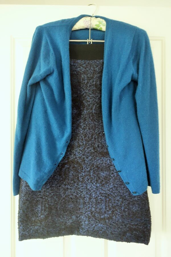 Blue cashmere cardigan and blue & black straight skirt