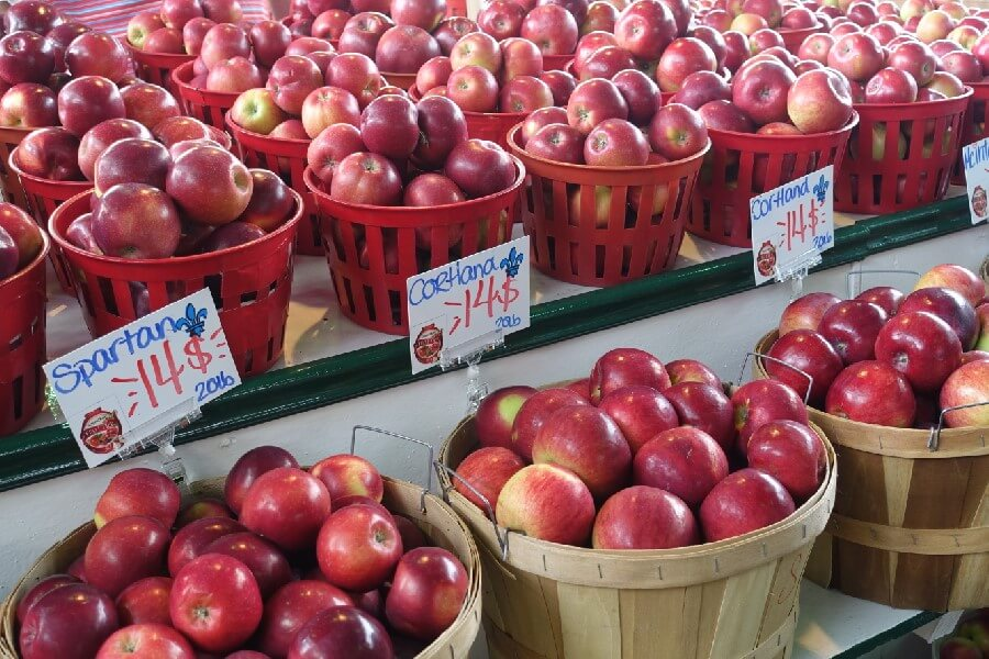 wooden baskets of red apples in a market