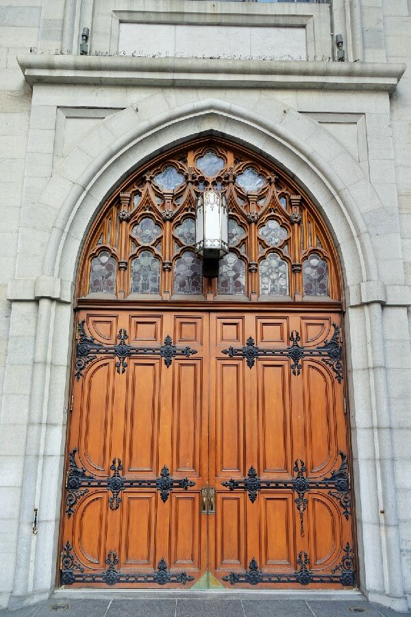 Wooden entrance door at Basilique Notre Dame Montreal