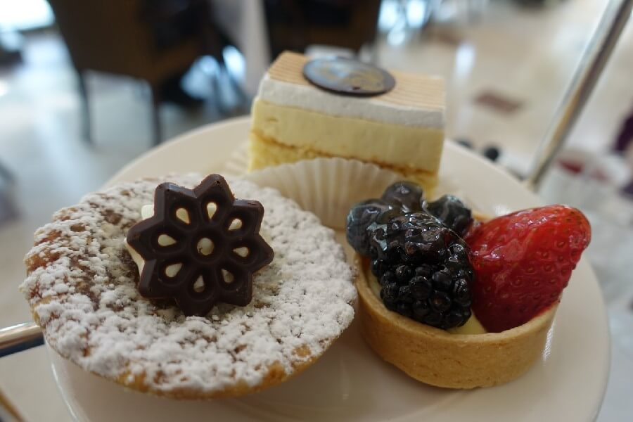 Afternoon tea at the Fairmont Chateau Laurier, Ottawa. Plate of three cakes