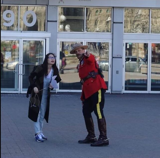 Mountie aiding a damsel in distress, Ottawa Canada