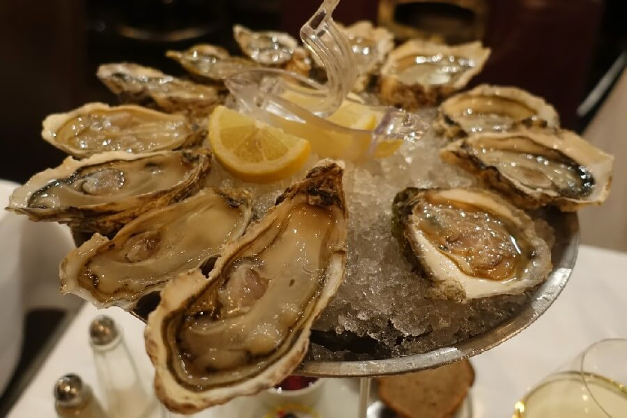 Plate of Paris oysters in a brasserie Best brasserie foods in Paris