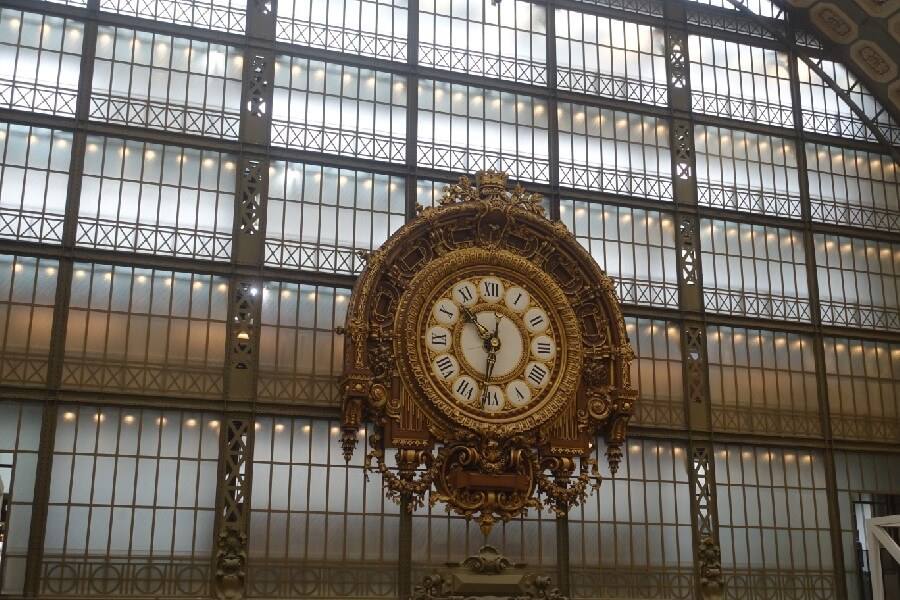 Join me on a Musee d'Orsay Private Tour frugal first class travel. A neoclassical French clock in the Musee d'Orsay