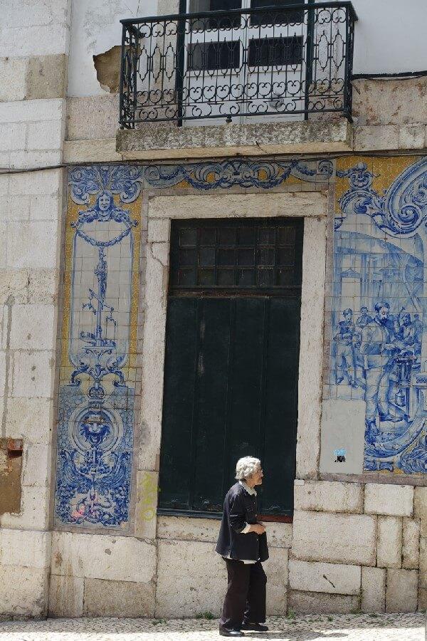 Old lady walking in Lisbon Exploring the Alfama: a fishing village in Lisbon
