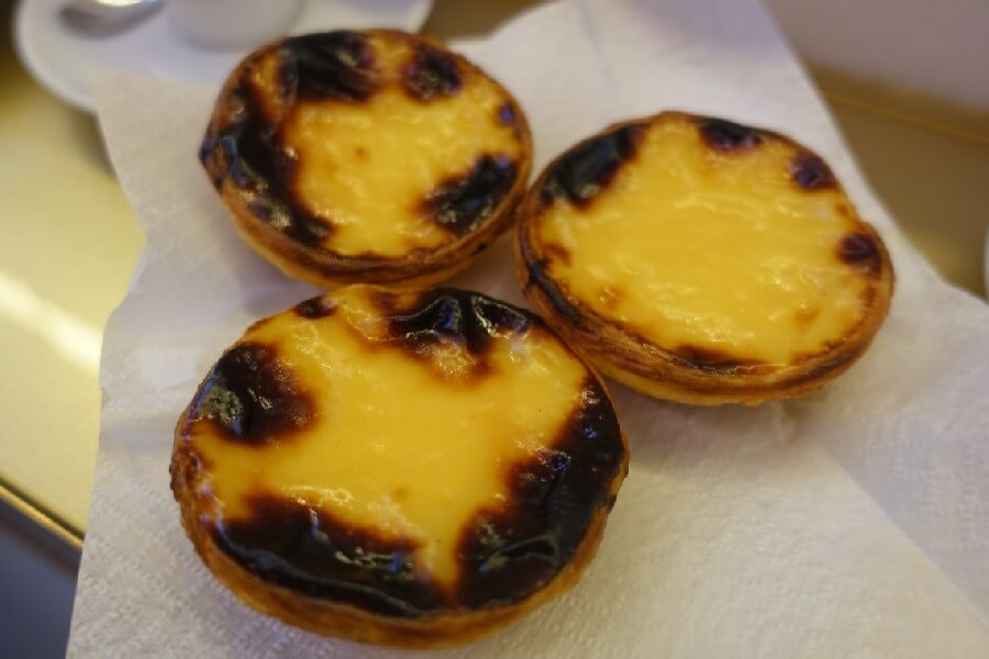 The best food walk in Lisbon with Culinary Backstreets Pasteis de nata in Lisbon Portuguese custard tart recipe