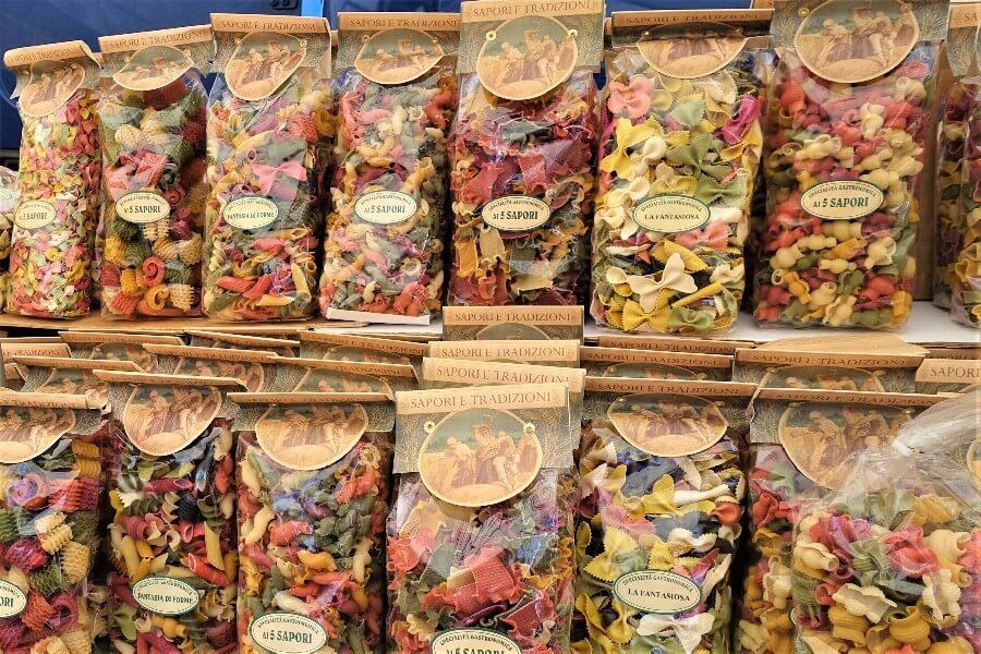 multicoloured pastas at the Ventimiglia market, Italy