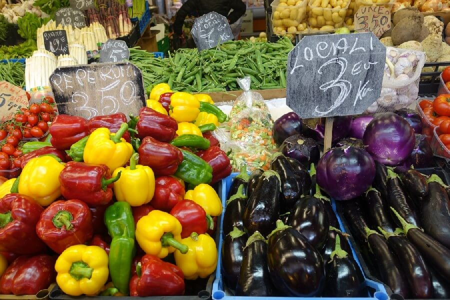 Yellow and red bell peppers, eggplants at Ventimiglia market