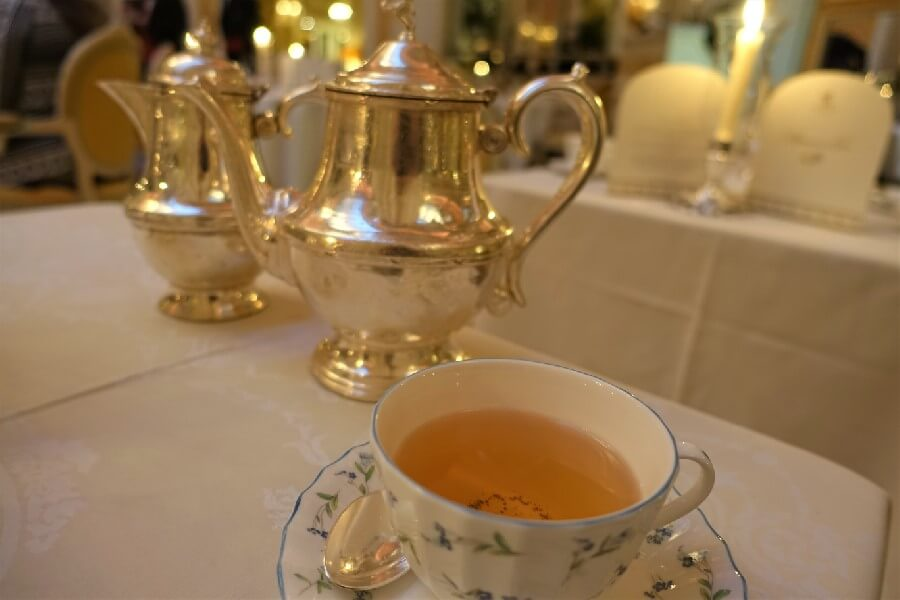 Cup of tea and silver tea pot Ritz London afternoon tea