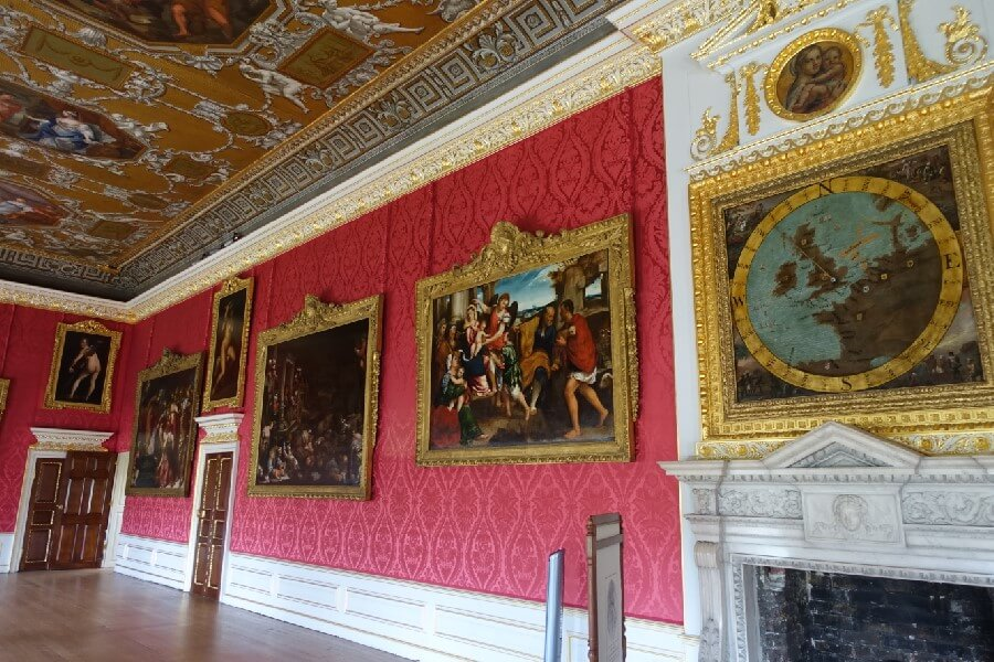 red wallpaper and portraits in the State Apartments Kensington Palace London