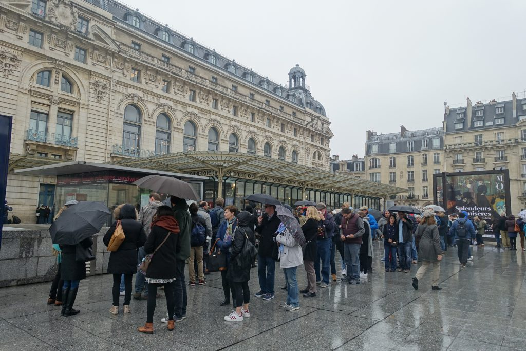wet day in Paris, queue at the Musee d'Orsay, entrance to Musee d'Orsay Paris
