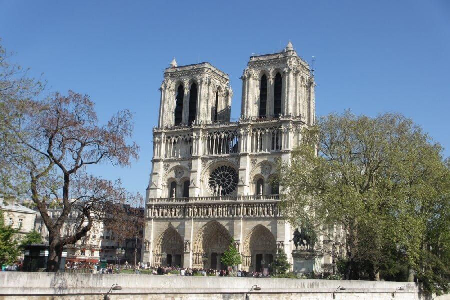 Facade of Notre Dame Cathedral Paris, entrance to Notre Dame Paris, Paris church