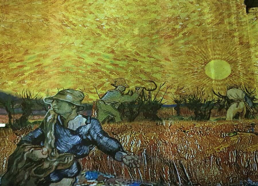 Farm workers in the field by Vincent Van Gogh Ateliers des Lumieres Paris 2019