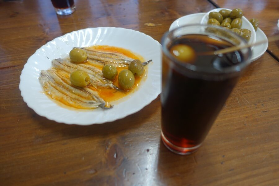 glass of vermuth and plate of anchovies in Barcelona