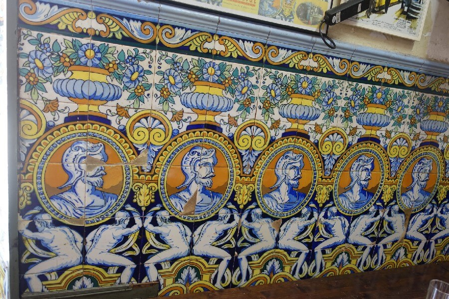 Traditional old tiles on a bodega wall in Barcelona