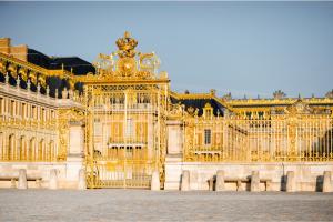 Golden entrance gates Chateau of Versailles France Palace of Versailles gates and entrance