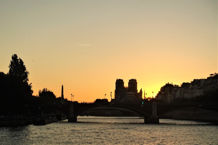 Notre Dame against the setting sun in Paris
