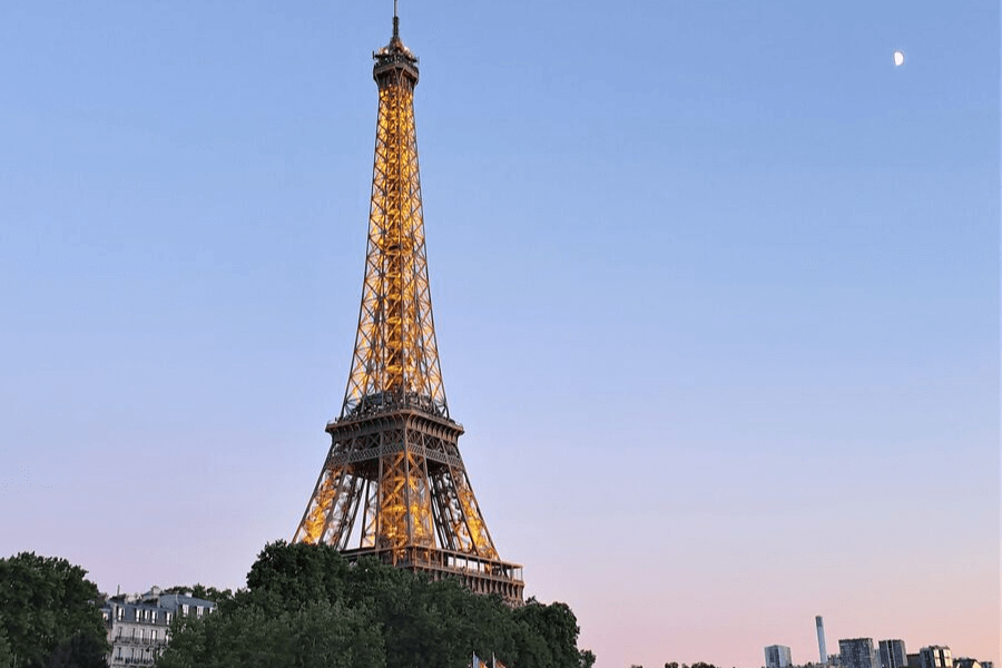 Eiffel Tower lighting up in Paris sunset
