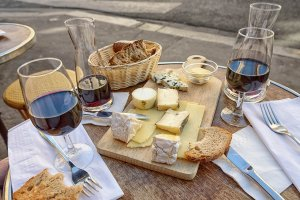Plate of cheese and red wine Paris cafe