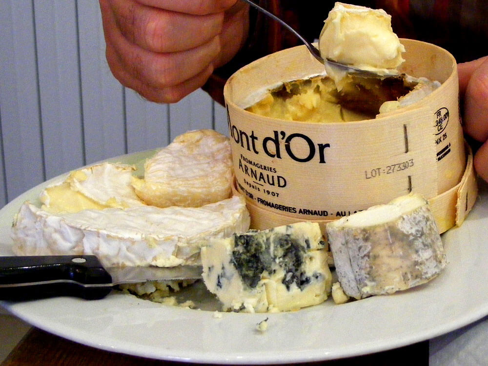 Montdor cheese in wooden container