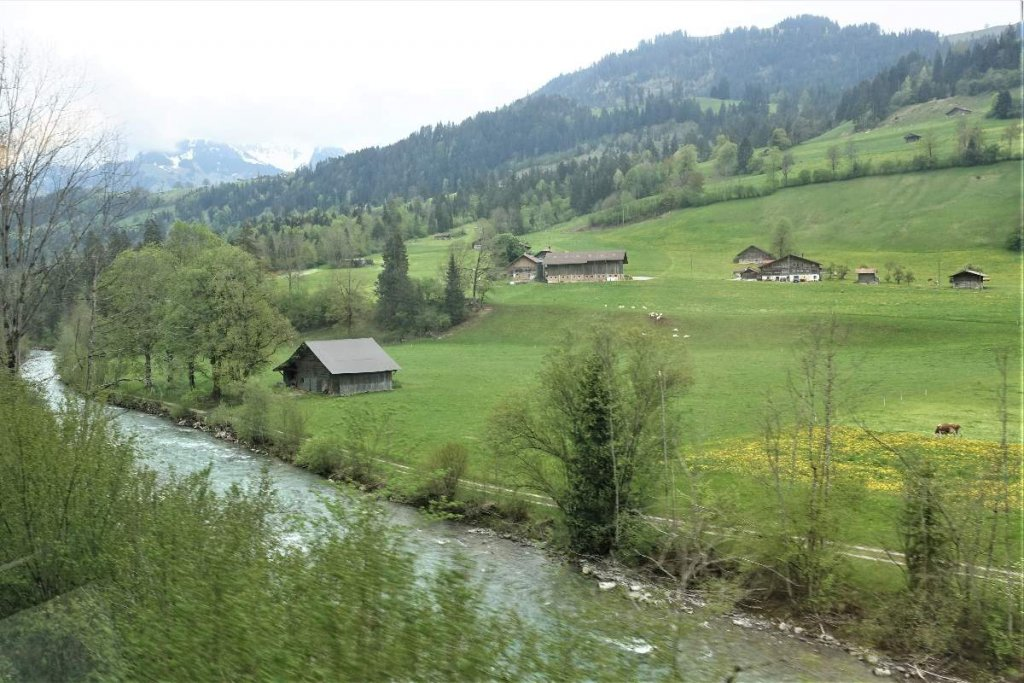 Interlaken to Montreux by train. Swiss countryside with river and mountains