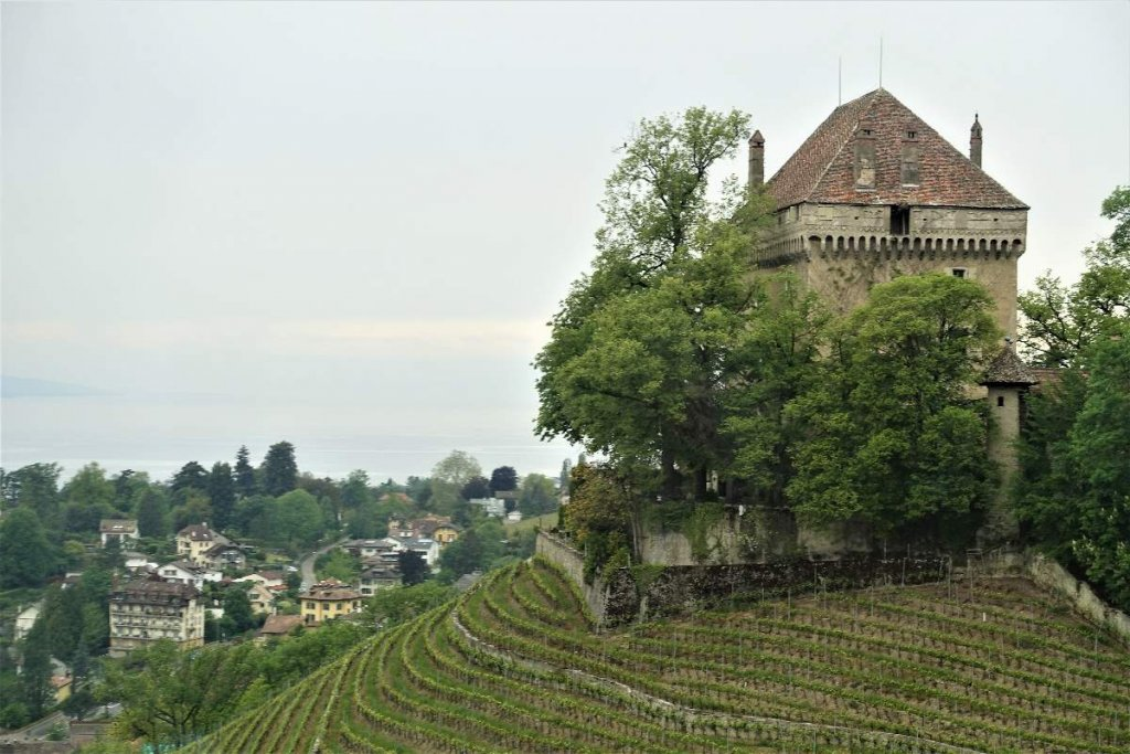 Chateau and vineyards on the hills outside Montreux Switzerland. Train Interlaken to Montreux