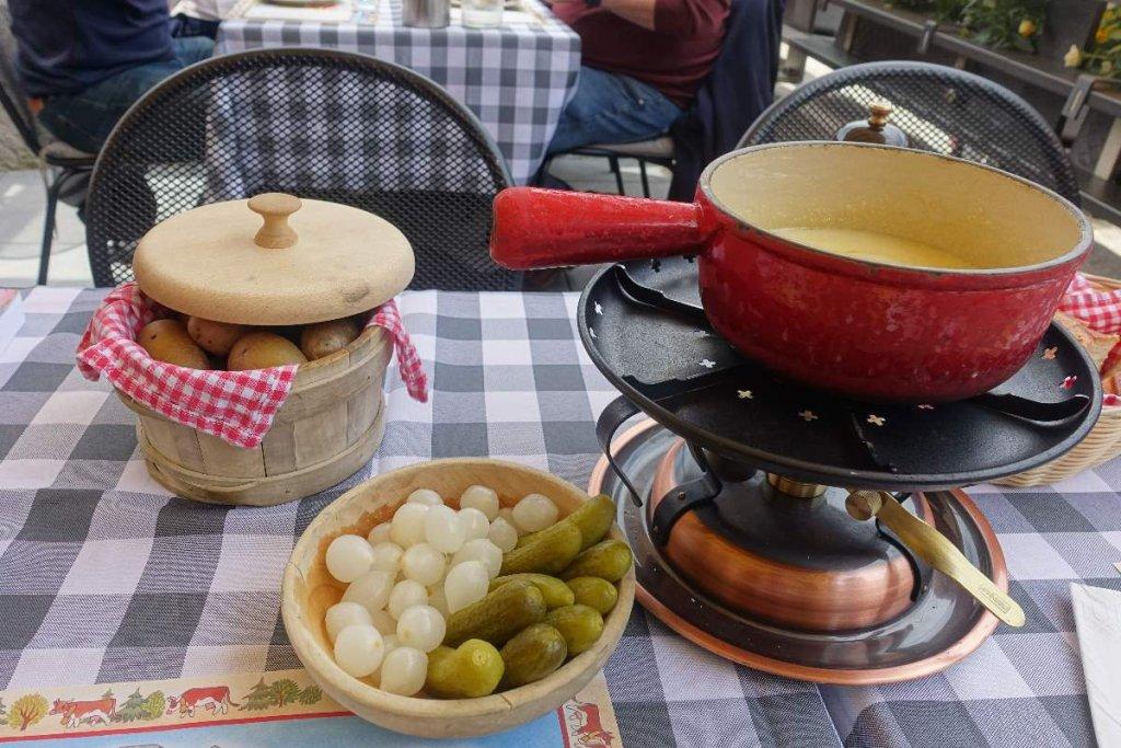 fondue with traditional accompaniments in Gruyere Switzerland