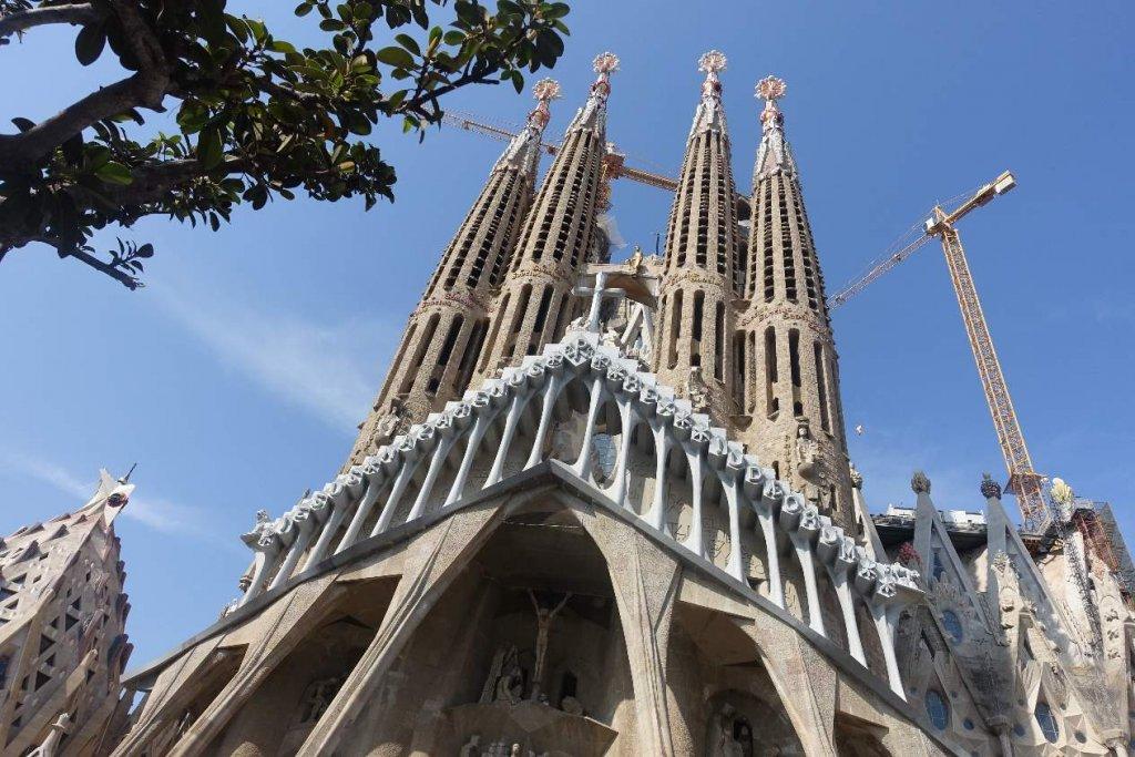 Sagrada Familia tips: Sagrada Familia inside visitFacade of Sagrada Familia with towers