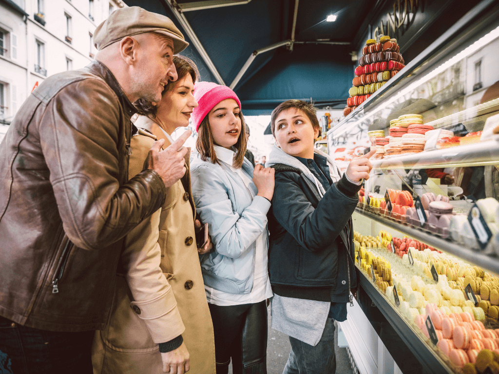 french family shopping in a patisserie